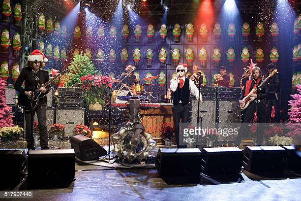 Musicians Dave Keuning Ronnie Vannucci Brandon Flowers and Mark Stoermer of musical guest The Killers perform on December 21 2006