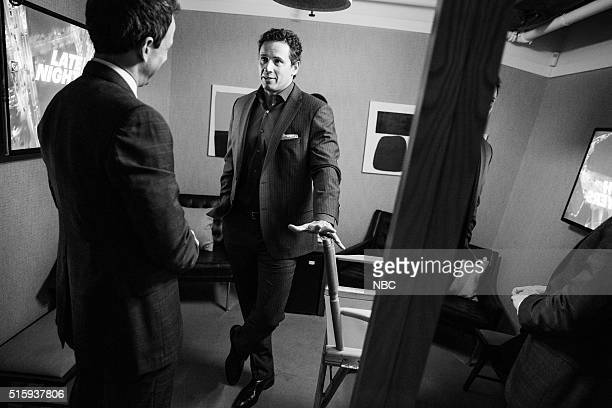 MEYERS Episode 340 Pictured Host Seth Meyers talks with journalist Chris Cuomo backstage on March 15 2016