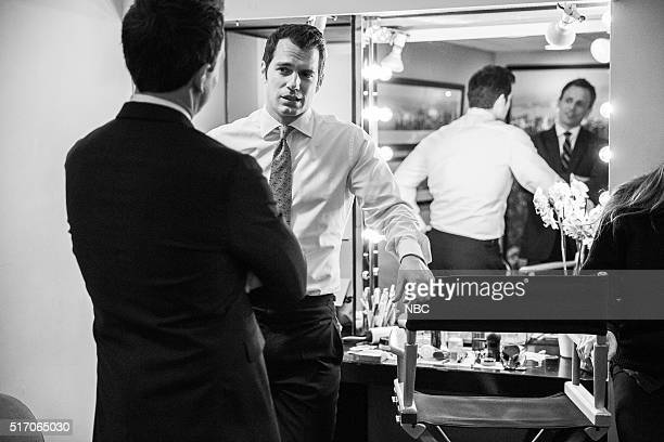 Host Seth Meyers talks with actor Henry Cavill backstage on March 22 2016