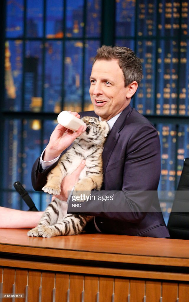 Host Seth Meyers holds a tiger cub on March 31, 2016 --