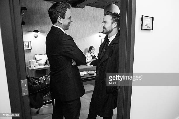 MEYERS Episode 364 Pictured Host Seth Meyers talks with actor Aaron Paul backstage on May 4 2016
