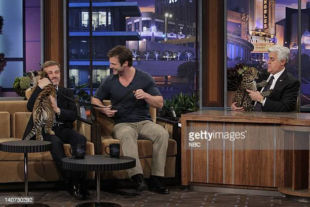 Actor Christoph Waltz animal expert Dave Salmoni play with a baby tiger and African Leopard during an interview with host Jay Leno on March 9 2010...