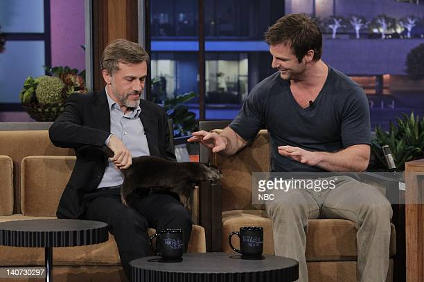 Actor Christoph Waltz handles a baby Otter with Animal expert Dave Salmoni during an interview on March 9 2010 Photo by Paul Drinkwater/NBCU Photo...