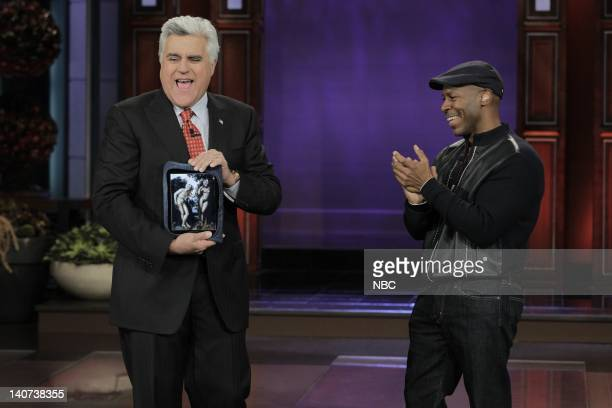 Host Jay Leno receives a denim iPad from Kevin Eubanks on April 28 2010 Photo by Paul Drinkwater/NBCU Photo Bank