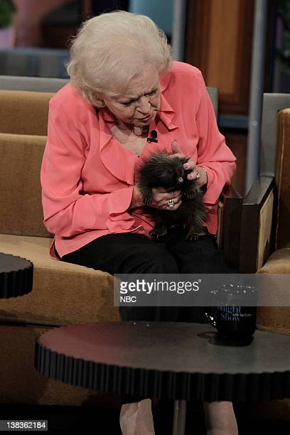 Actress Betty White handles a baby porcupine during an interview on May 12 2010