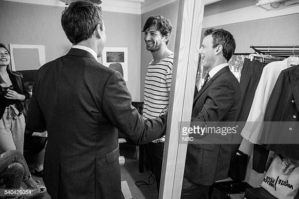 MEYERS Episode 383 Pictured Host Seth Meyers talks with actor Michiel Huisman backstage on June 14 2016
