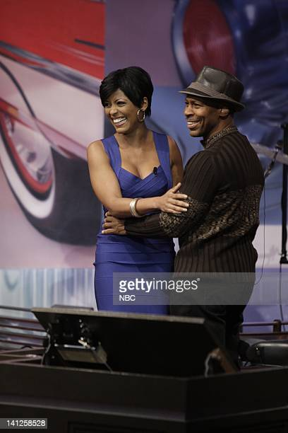 MSNBC anchor Tamron Hall surprises Tonight Show band leader Kevin Eubanks on May 26 2010 Photo by Paul Drinkwater/NBCU Photo Bank