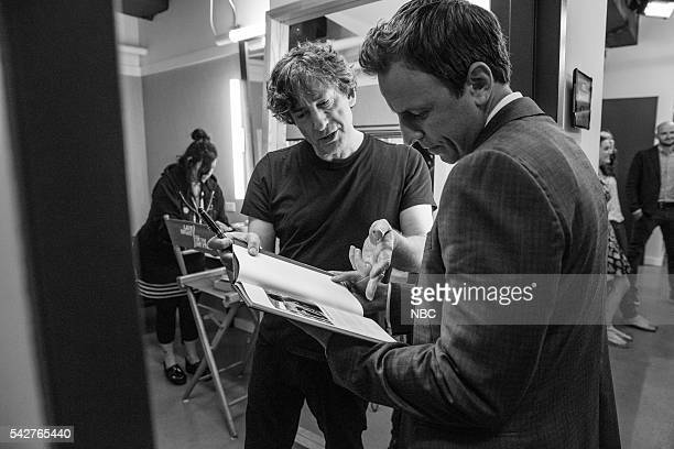 MEYERS Episode 389 Pictured Author Neil Gaiman talks with host Seth Meyers backstage on June 23 2016