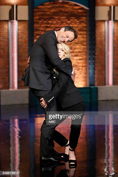 Host Seth Meyers greets actress Kate McKinnon on July 12 2016