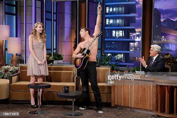 Comedian Dane Cook performs a song for singer Taylor Swift during an interview with host Jay Leno on November 22 2010
