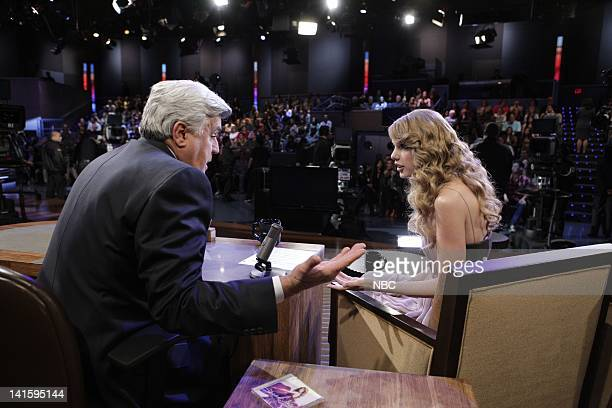 LENO Episode 3936 Pictured Host Jay Leno talks to singer Taylor Swift during a commercial break on November 22 2010 Photo by Paul Drinkwater/NBC/NBCU...