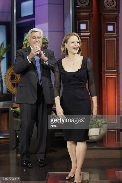 Host Jay Leno greets actress/director Jodie Foster on May 13 2011 Photo by Stacie McChesney/NBC/NBCU Photo Bank