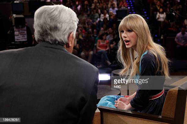 Host Jay Leno talks to Taylor Swift during a commercial break on February 20 2012