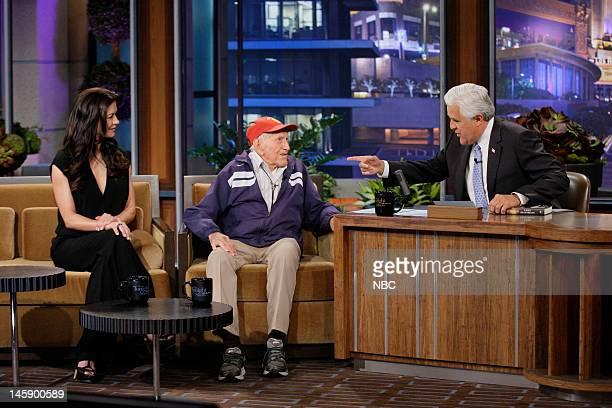 Actress Catherine ZetaJones 95 year old war hero Louis Zamperini during an interview with host Jay Leno on June 7 2012
