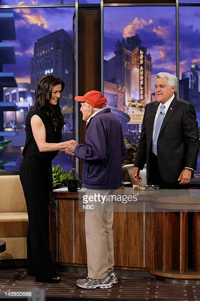 Actress Catherine ZetaJones greets 95 year old war hero Louis Zamperini during an interview with host Jay Leno on June 7 2012