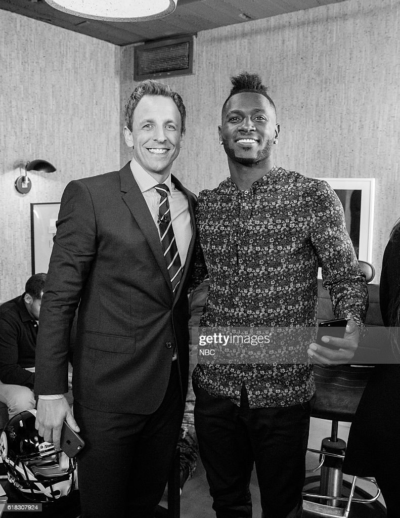 MEYERS -- (EXCLUSIVE COVERAGE) -- Episode 438 -- Pictured: (l-r) Host Seth Meyers with football player Antonio Brown backstage on October 25, 2016 --
