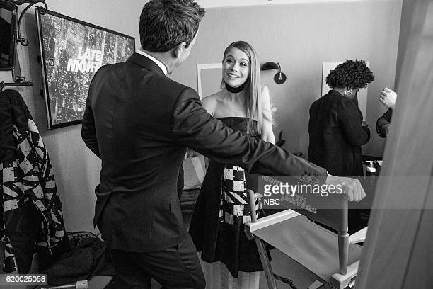 MEYERS Episode 441 Pictured Host Seth Meyers talks with actress Genevieve Angelson backstage on October 31 2016