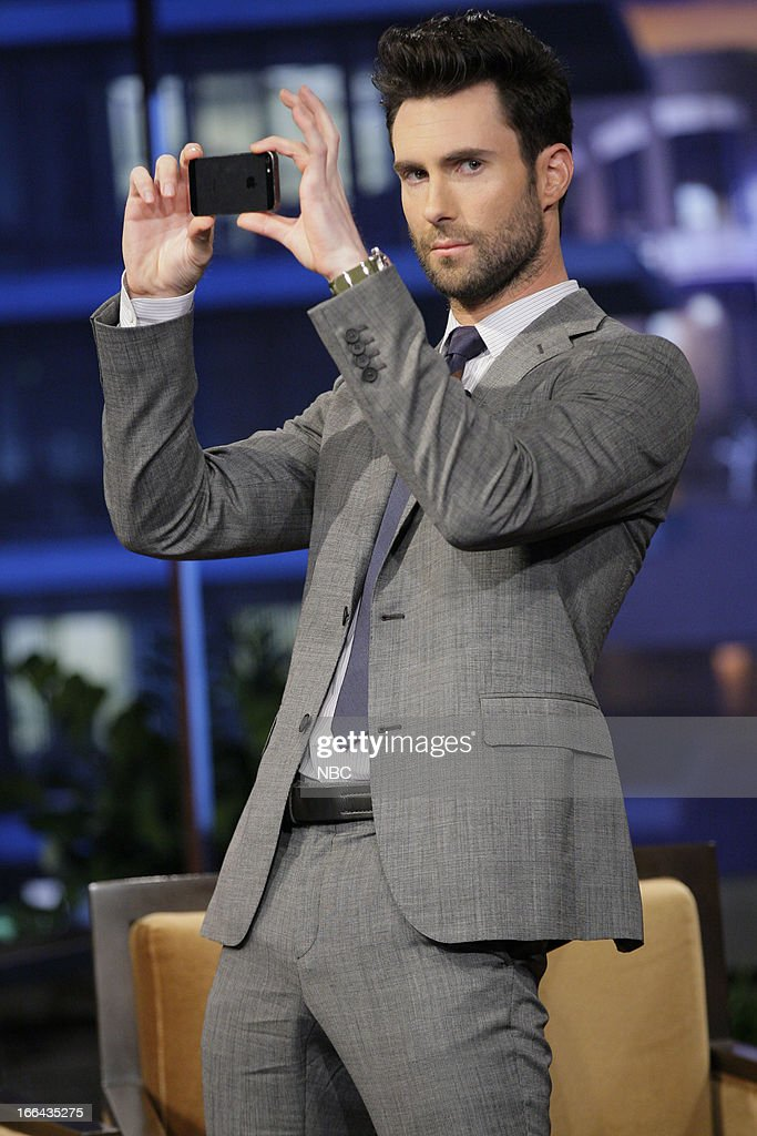 LENO -- (EXCLUSIVE COVERAGE) -- Episode 4444 -- Pictured: Adam Levine takes a picture of the audience during a commercial break on April 12, 2013 --