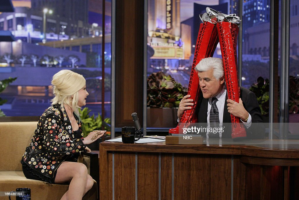Cyndi Lauper gives host Jay Leno a pair of go-go boots during an interview on April 12, 2013 --