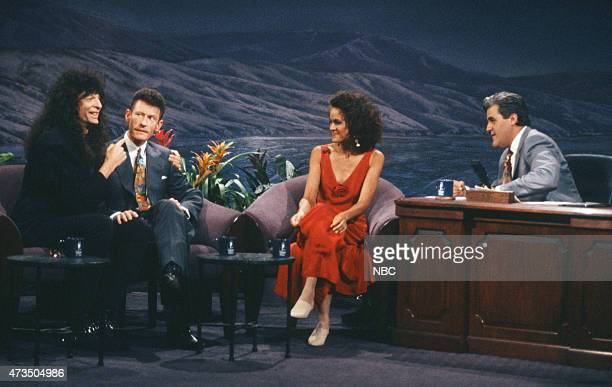 Radio personality Howard Stern musical guest Lyle Lovett actress AnneMarie Johnson during an interview with host Jay Leno on July 24 1992