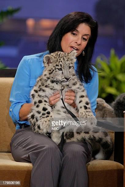Busch Garden's animal expert Julie Scardina with a baby snow leopard during an interview on August 29 2013