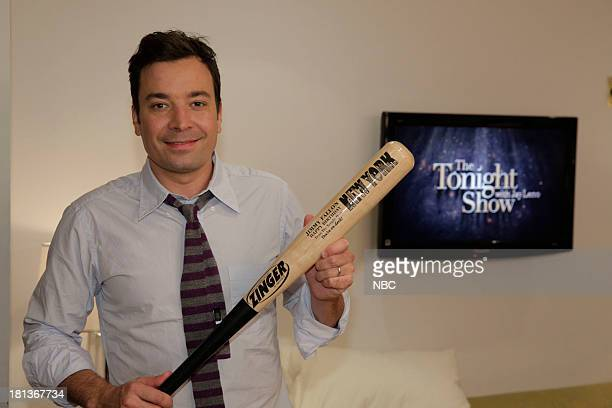 LENO Episode 4533 Pictured Late Night host Jimmy Fallon shows off his birthday bat from the Tonight Show backstage on September 20 2013