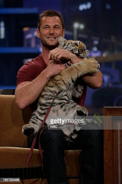 Animal expert Dave Salmoni with a bengal tiger during an interview on October 24 2013