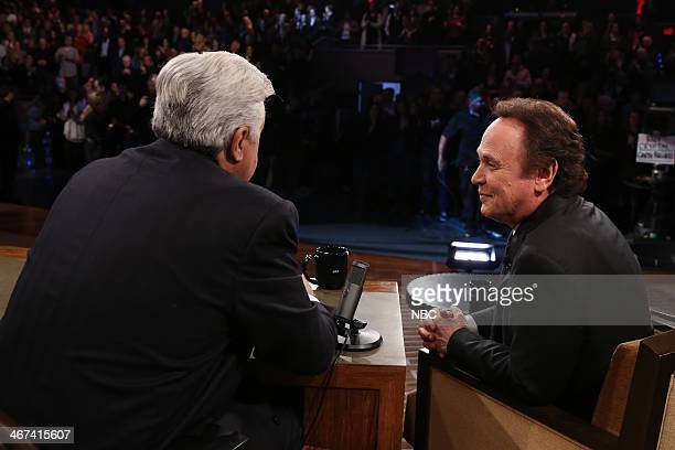 LENO Episode 4610 Pictured Host Jay Leno talks with actor Billy Crystal during a commercial break on February 6 2014