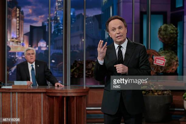Host Jay Leno watches as actor Billy Crystal reminisces on Jay's 22 season run on the Tonight Show on February 6 2014