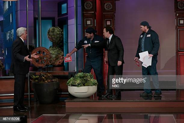 Host Jay Leno watches as actor Billy Crystal puts up moving signs on the set on February 6 2014