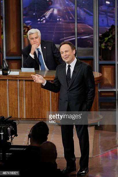 Host Jay Leno watches as comedian Billy Crystal performs on February 6 2014