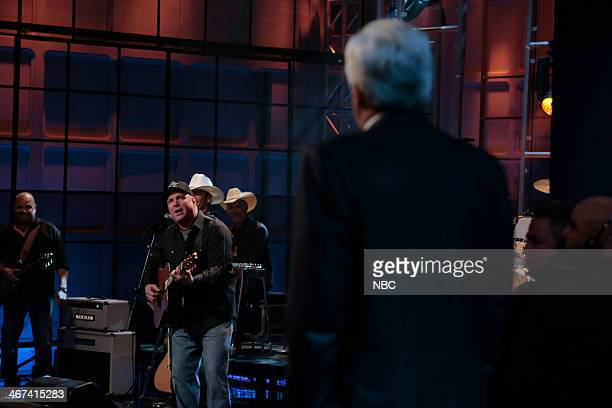 Host Jay Leno watches as musical guest Garth Brooks performs the final song on February 6 2014