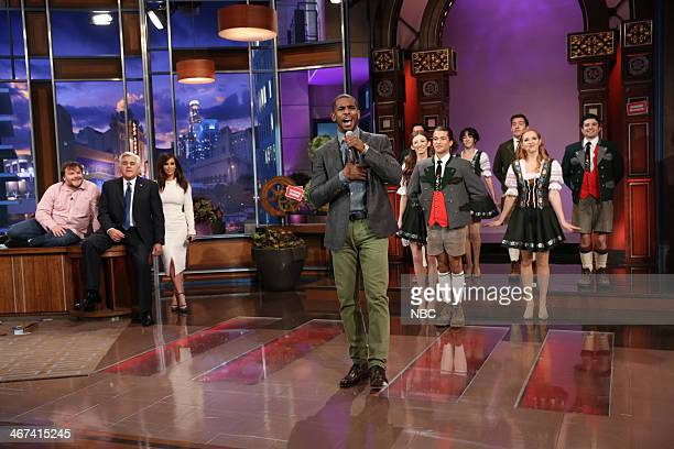 Jack Black host Jay Leno and Kim Kardashian watch as basketball player Chris Paul performs during the Farewell Song on February 6 2014
