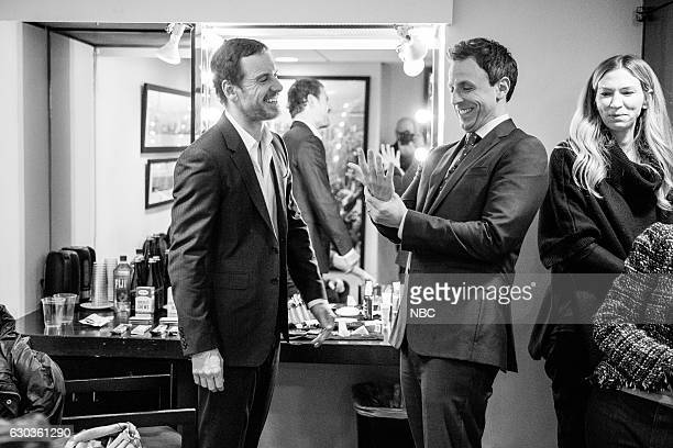 MEYERS Episode 465 Pictured Actor Michael Fassbender talks with host Seth Meyers backstage on December 20 2016