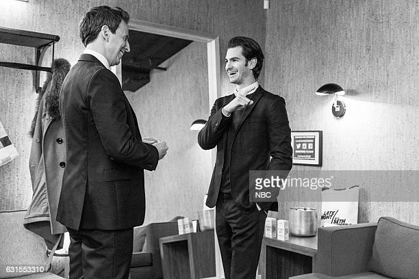 MEYERS Episode 470 Pictured Host Seth Meyers talks with actor Andrew Garfield backstage on January 11 2017