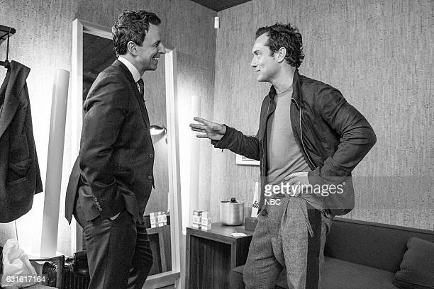 MEYERS Episode 471 Pictured Host Seth Meyers talks with atctor Jude Law backstage on January 12 2017