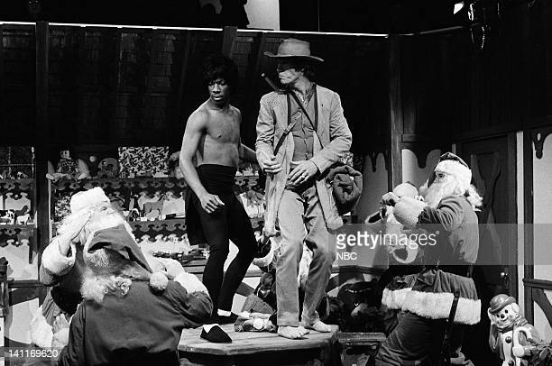 Eddie Murphy as Bruce Lee David Carradine as Caine during the 'Kung Fu Christmas' skit on December 20 1980 Photo by Alan Singer/NBC/NBCU Photo Bank