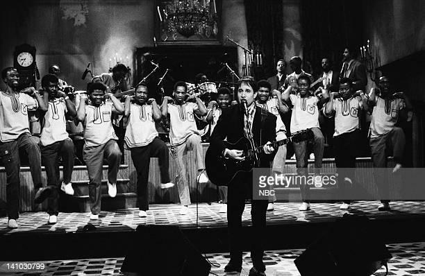 Musical guest Paul Simon performs with Ladysmith Black Mambazo on November 22 1986 Photo by Reggie Lewis/NBC/NBCU Photo Bank
