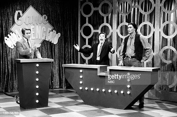Phil Hartman as Flip Mallory Mike Myers as Matt Kendall Jimmy Smits as Peter Running Dove during the 'Game Challengers' skit on November 10 1990