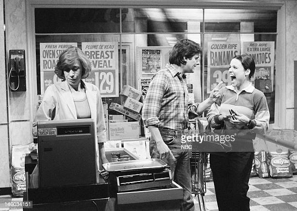 Robin Duke as cashier Gary Kroeger as husband Julia LouisDreyfus as wife during 'My Wife Is a Witch' skit on November 12 1983