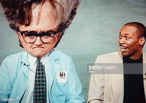 Host Jay Leno with 'Tonight Show Band' leader Kevin Eubanks during a 'Mr Brain' skit on July 21 1994