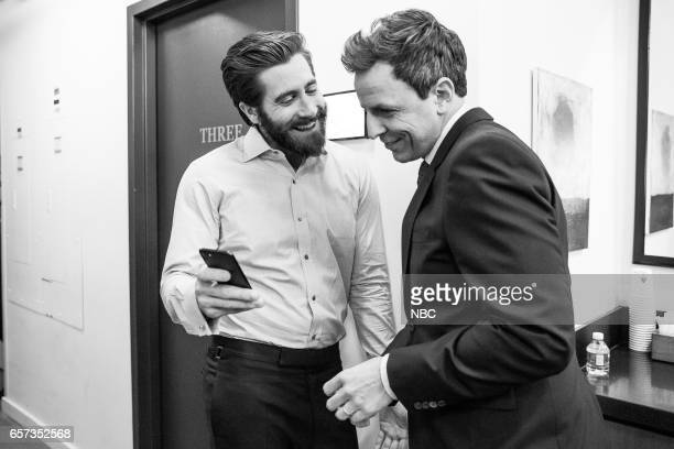 MEYERS Episode 507 Pictured Actor Jake Gyllenhaal talks with host Seth Meyers backstage on March 23 2017