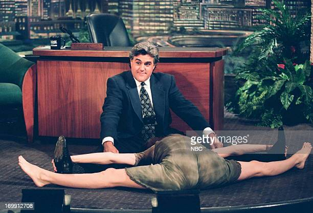 Actress Sean Young does the splits during an interview with host Jay Leno on August 01 1994