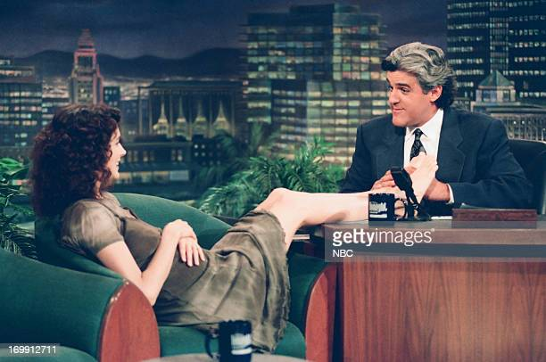Actress Sean Young puts her feet on the desk during an interview with host Jay Leno on August 01 1994