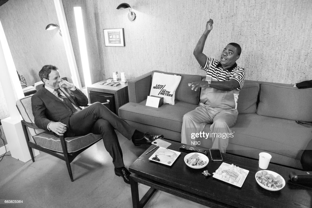 MEYERS -- (EXCLUSIVE COVERAGE) -- Episode 528 -- Pictured: (l-r) Host Seth Meyers talks with comedian Tracy Morgan backstage on May 15, 2017 --