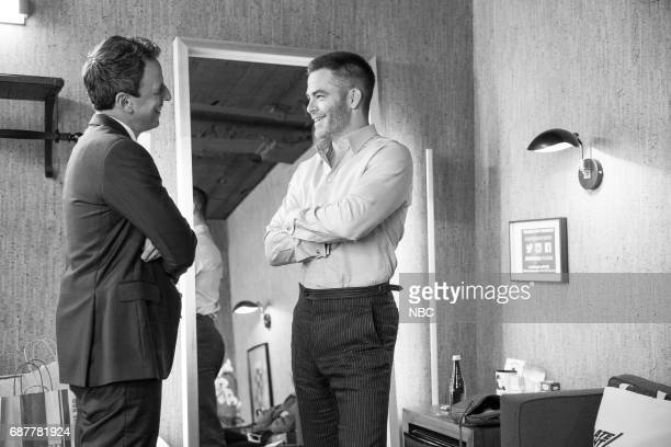 MEYERS Episode 533 Pictured Host Seth Meyers talks with actor Chris Pine backstage on May 23 2017