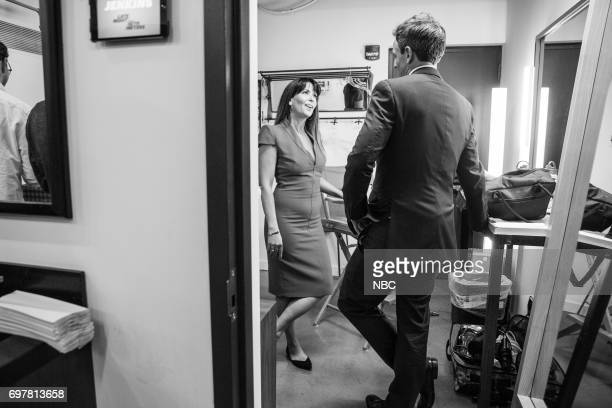 MEYERS Episode 543 Pictured Director Patty Jenkins talks with host Seth Meyers backstage on June 15 2017