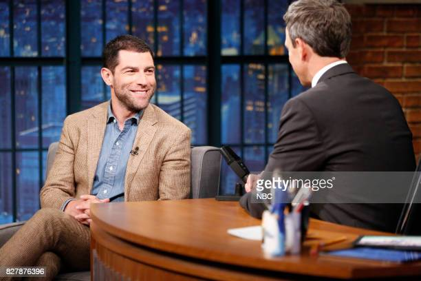Actor Max Greenfield talks with host Seth Meyers during an interview on August 8 2017