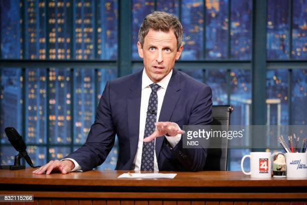 Host Seth Meyers at his desk during the monologue on August 15 2017