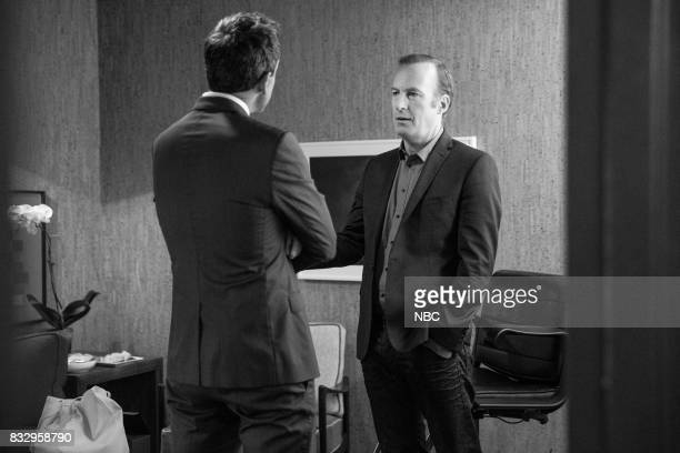 MEYERS Episode 570 Pictured Host Seth Meyers talks with actor Bob Odenkirk backstage on August 16 2017